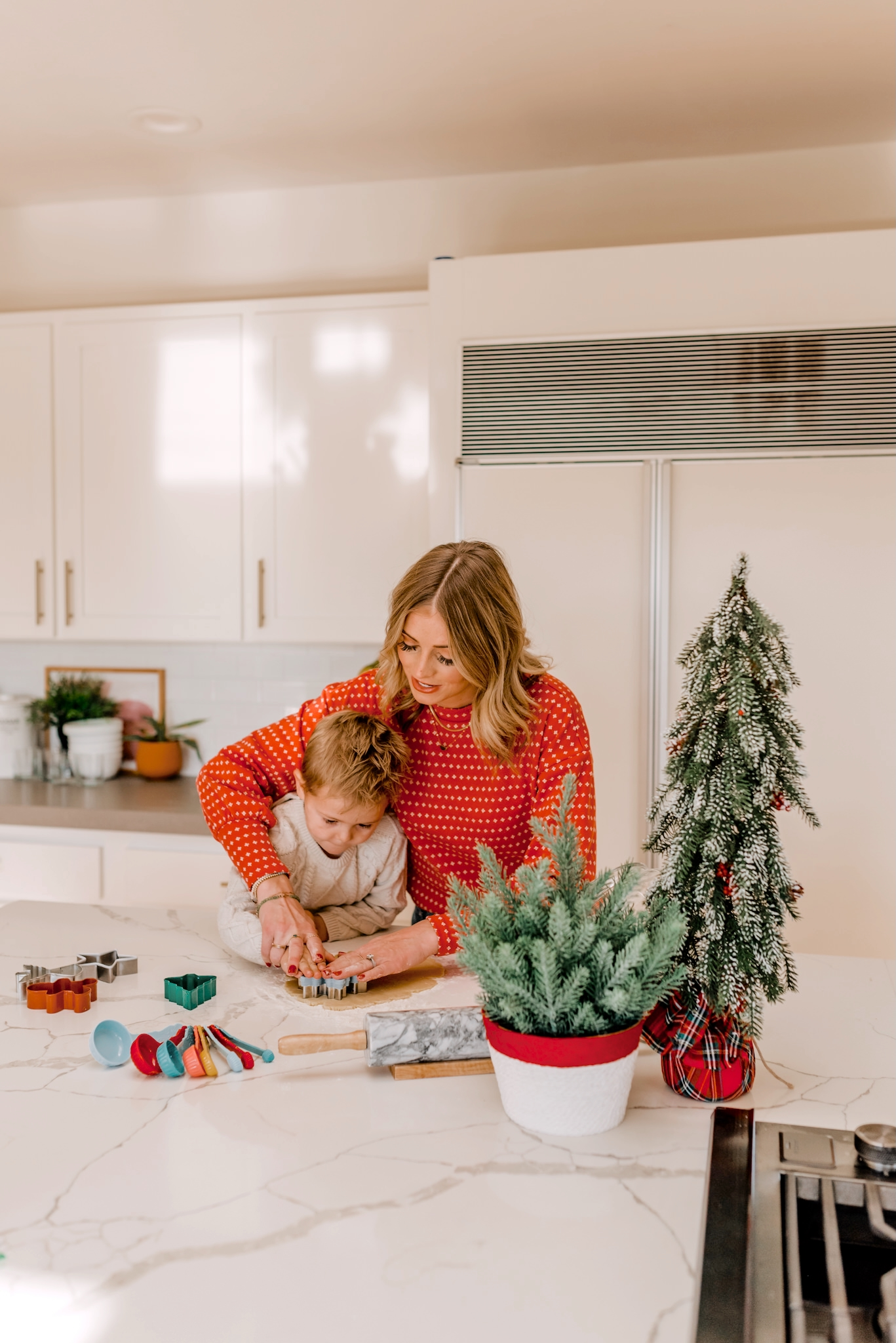Holiday Traditions with Walmart by popular San Diego lifestyle blog, Navy Grace: image of a mom and her young son making Christmas sugar cookies in their kitchen.