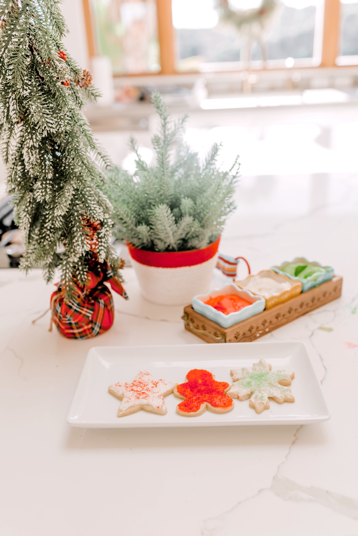 Holiday Traditions with Walmart by popular San Diego lifestyle blog, Navy Grace: image of Christmas shaped sugar cookies on a white rectangular dish.