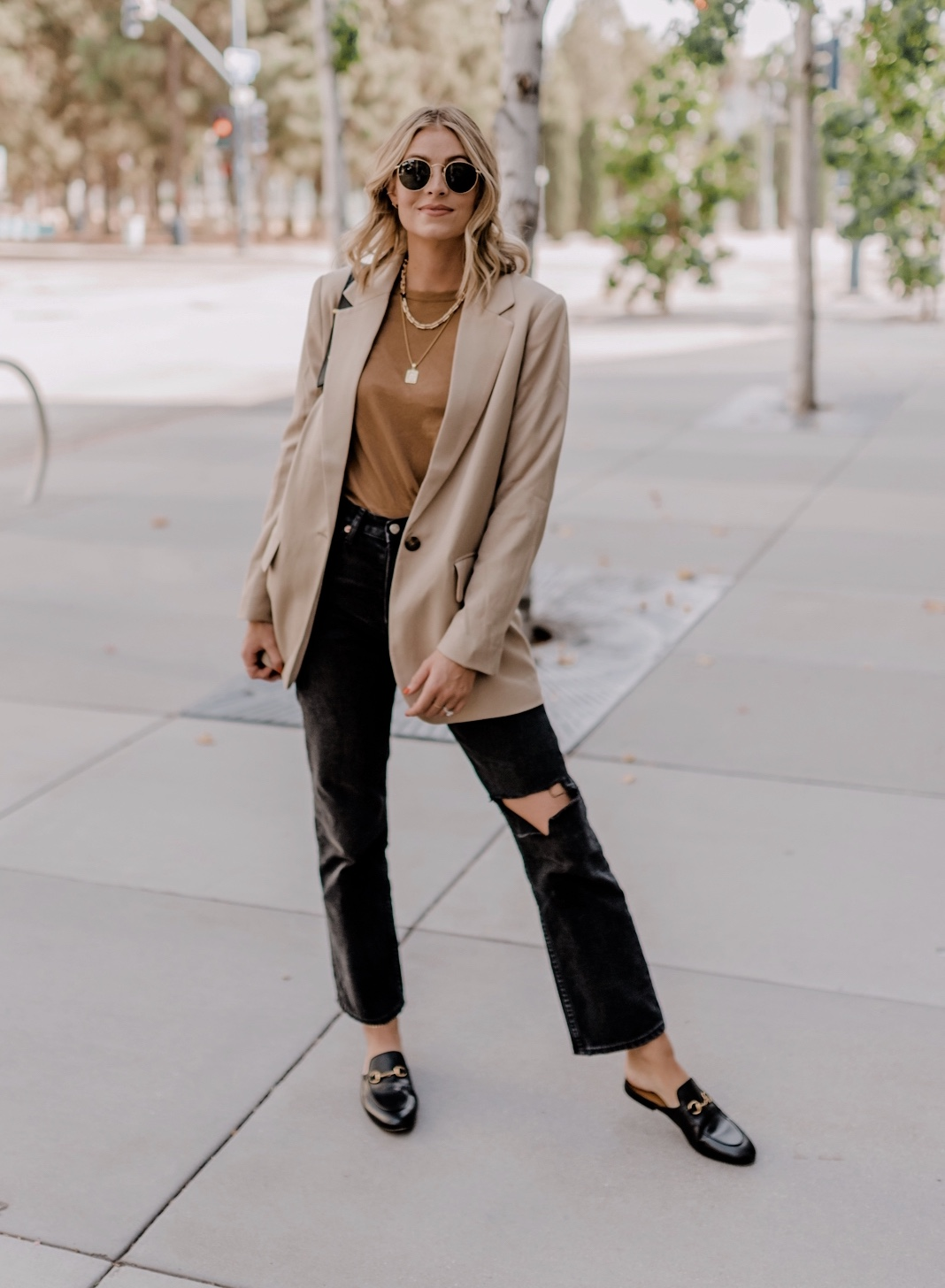 Top Looks of 2020 |Top Looks by San Diego fashion blog, Navy Grace: image of a woman wearing a tan blazer, brown shirt, black distressed denim and black slide mules.