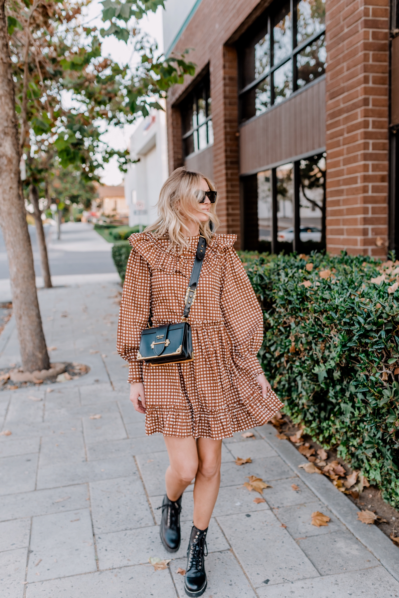 Top Looks of 2020 |Top Looks by San Diego fashion blog, Navy Grace: image of a woman wearing a brown brown gingham dress, black combat boots, and black Prada bag.