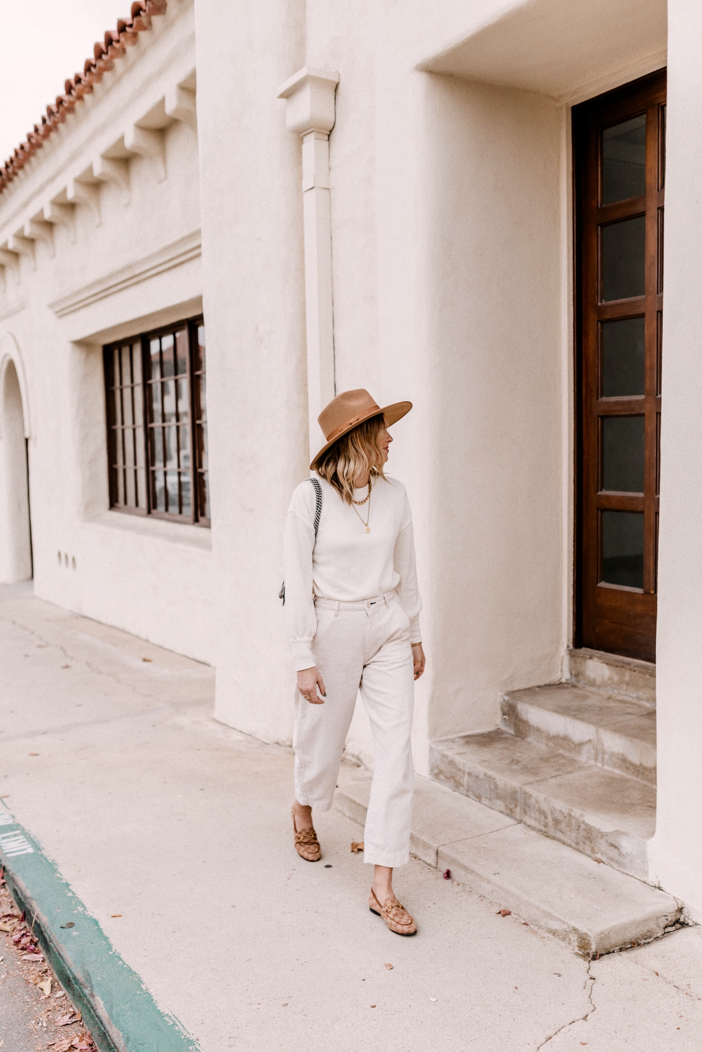 latest amazon buys |Amazon Buys by popular San Diego life and style blog, Navy Grace: image of a woman wearing an all white outfit with tan Gucci loafers and a tan felt fedora hat.