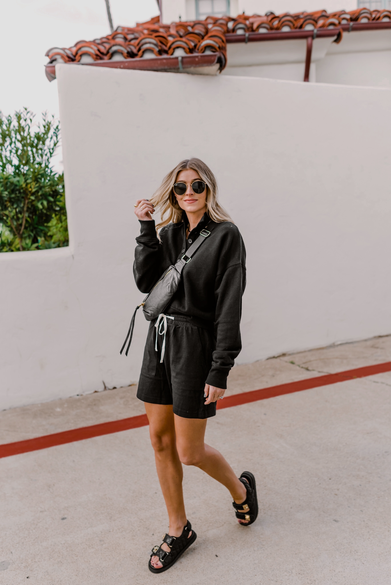 black sweater and shorts for spring