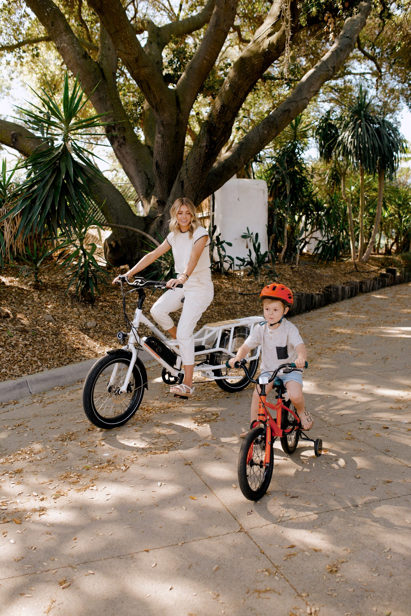 mom and kid riding a bike for things to do with kids