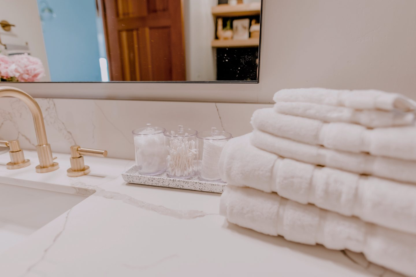 white towels on a sink for Decor Essentials for Hosting Guests
