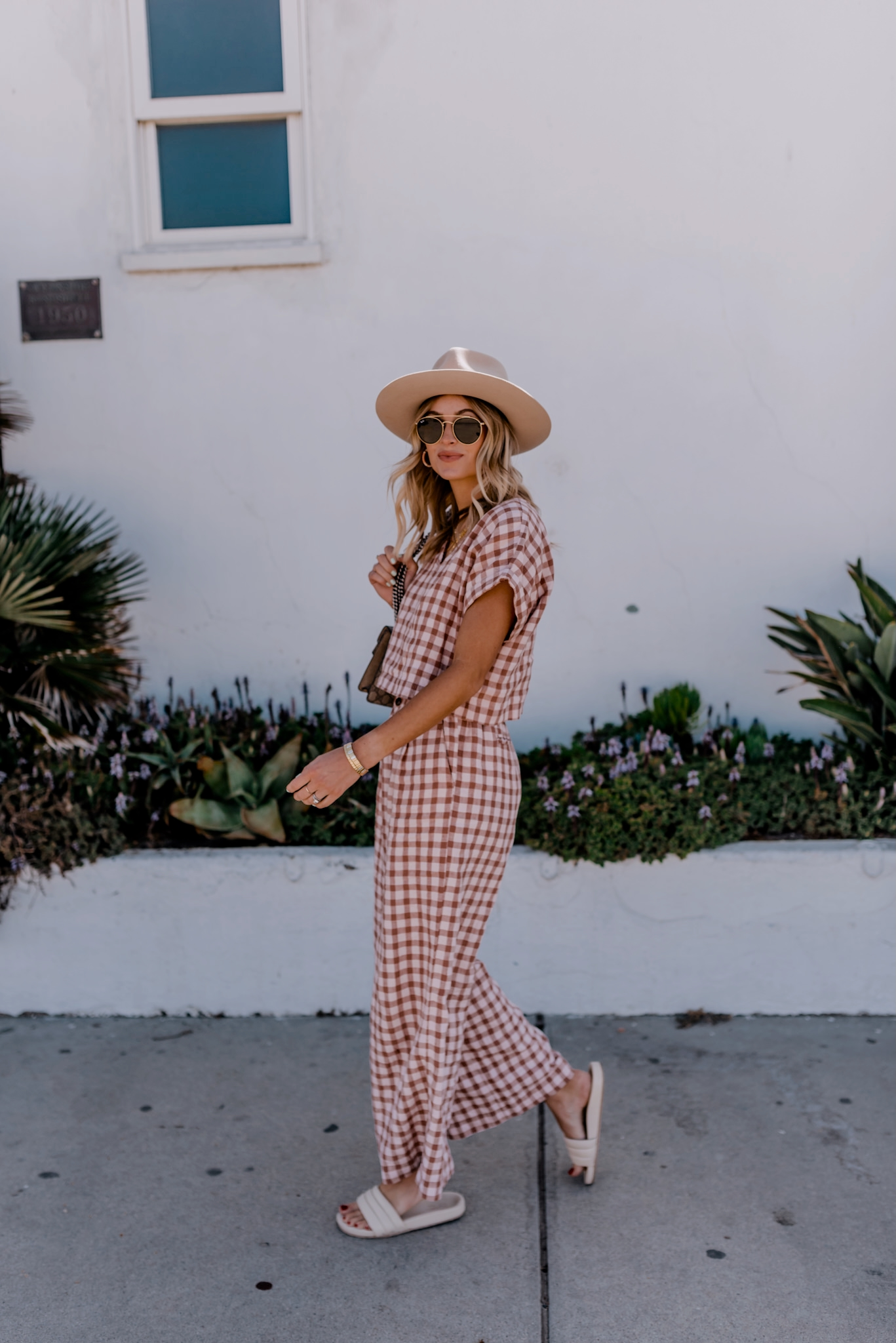 woman wearing checkered clothes and a hat