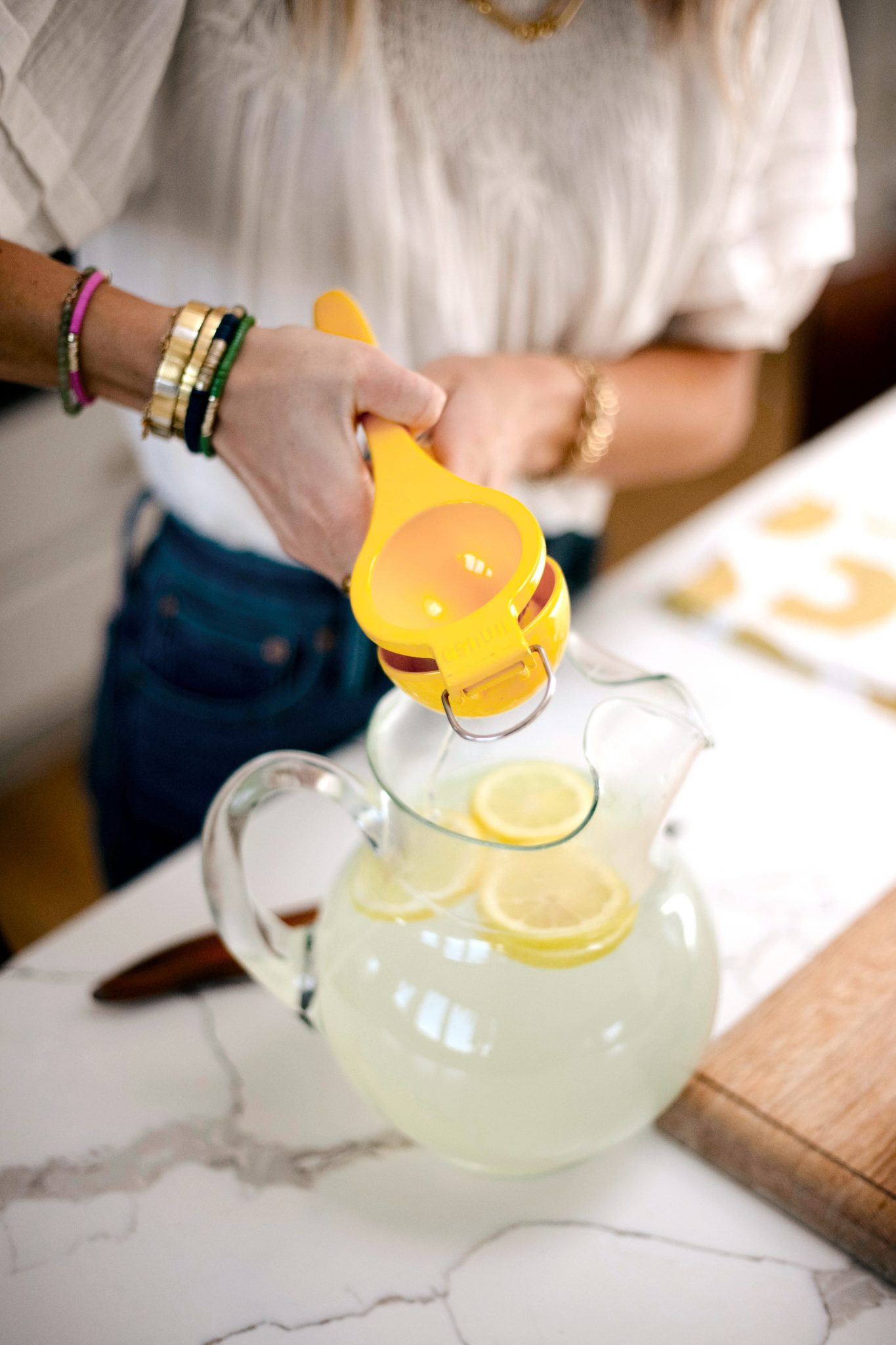 woman using lemon squeezer