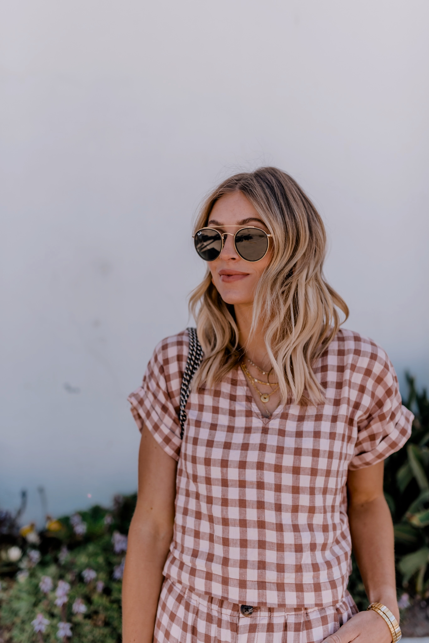 woman wearing sunglasses as one of the things she brought in amazon in june