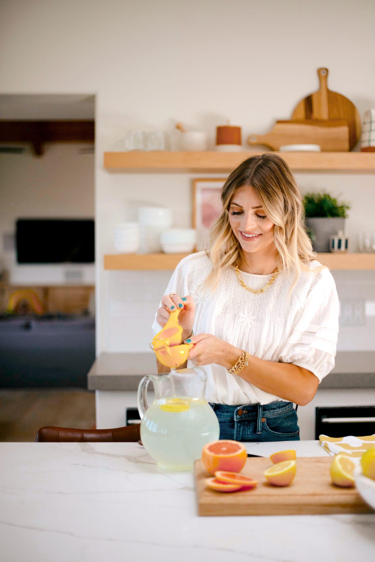 woman squeezing lemon for lemonade