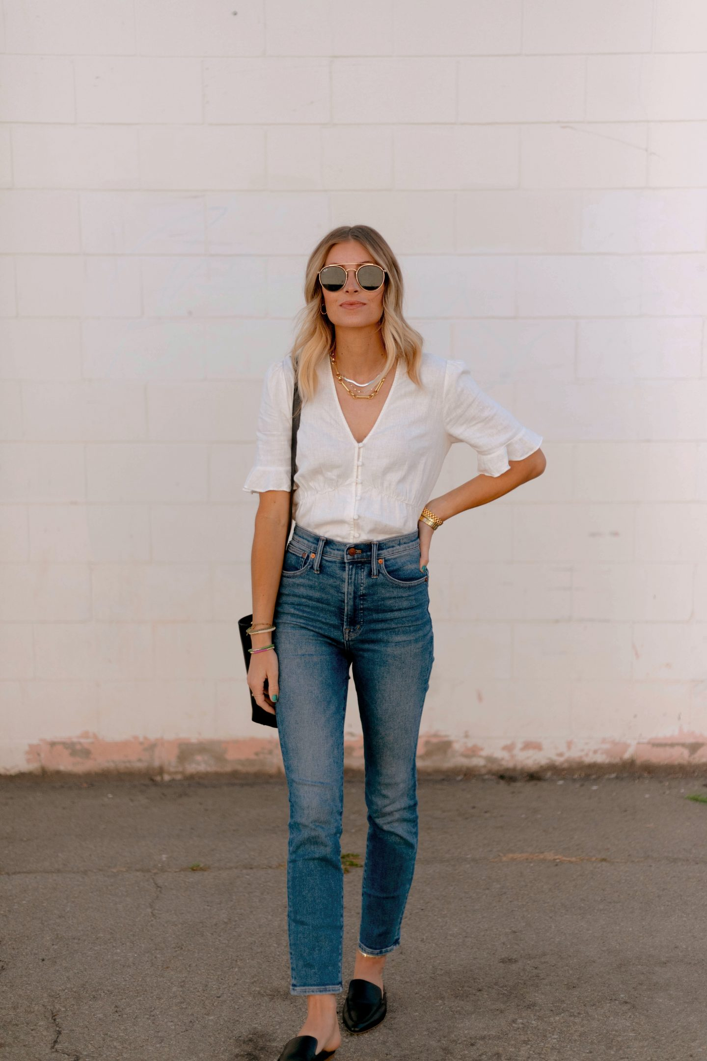 woman wearing white top and denim jeans