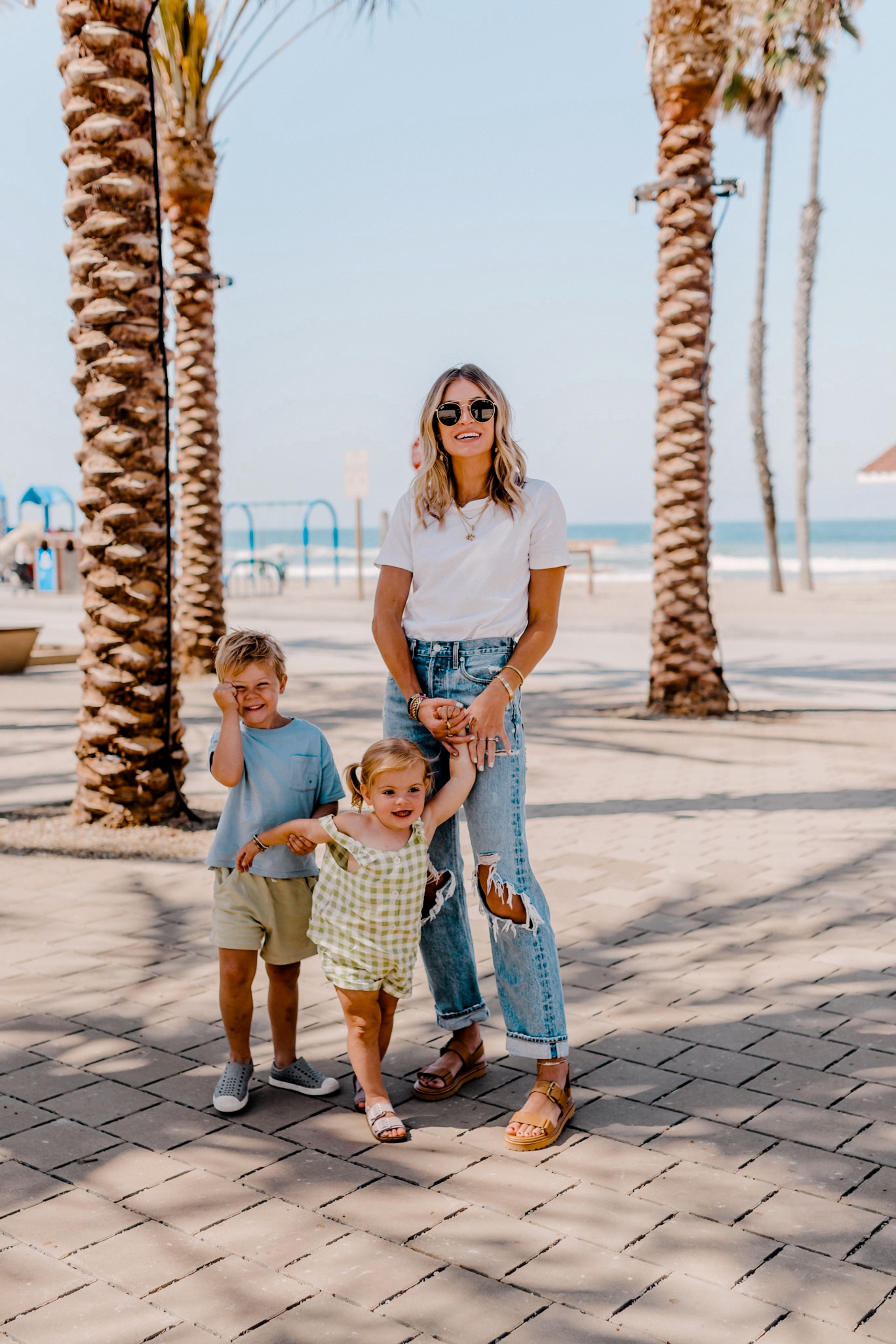 woman with her kids near the beach