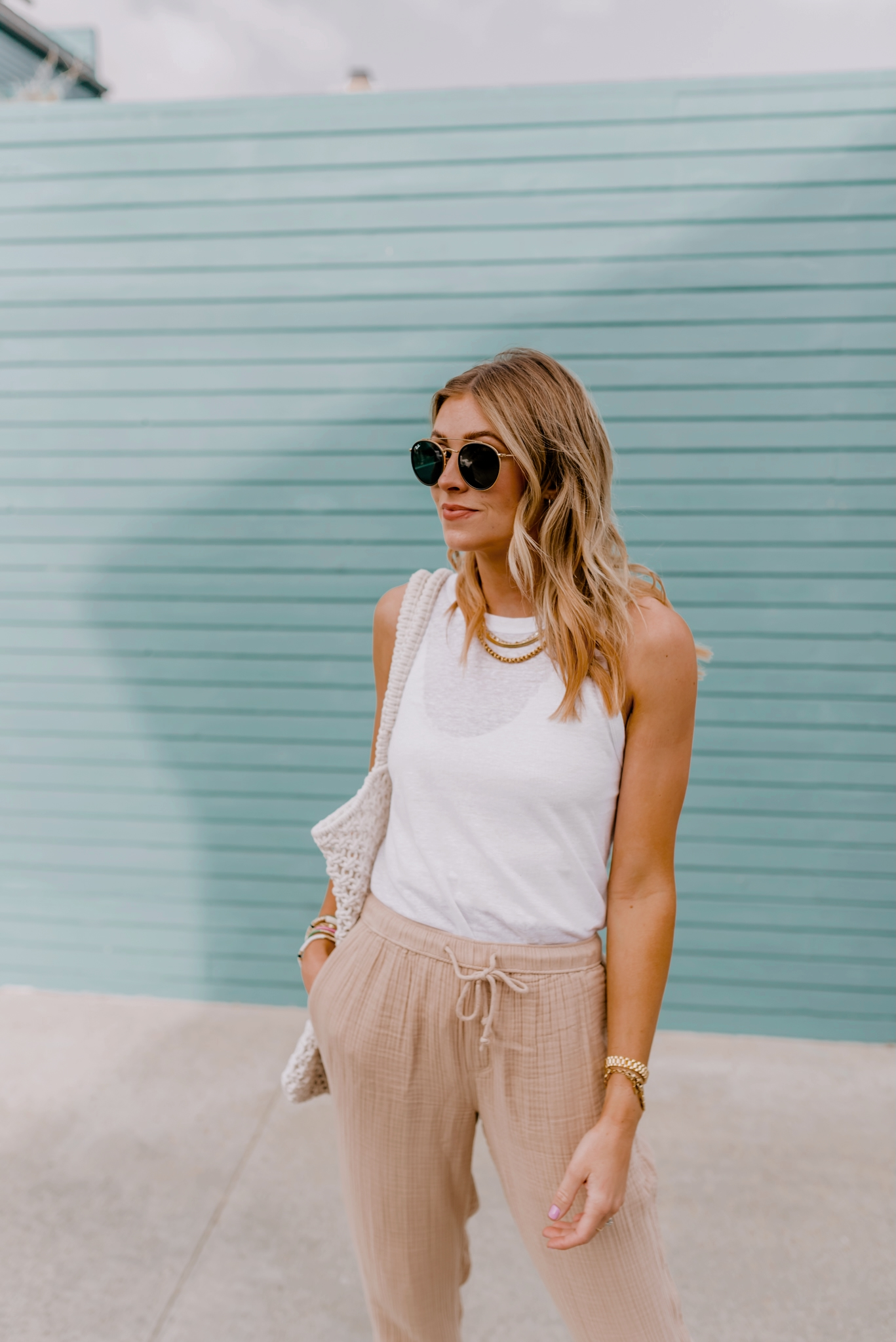 woman posing and wearing white top and sunglasses from Amazon home and fashion favorites