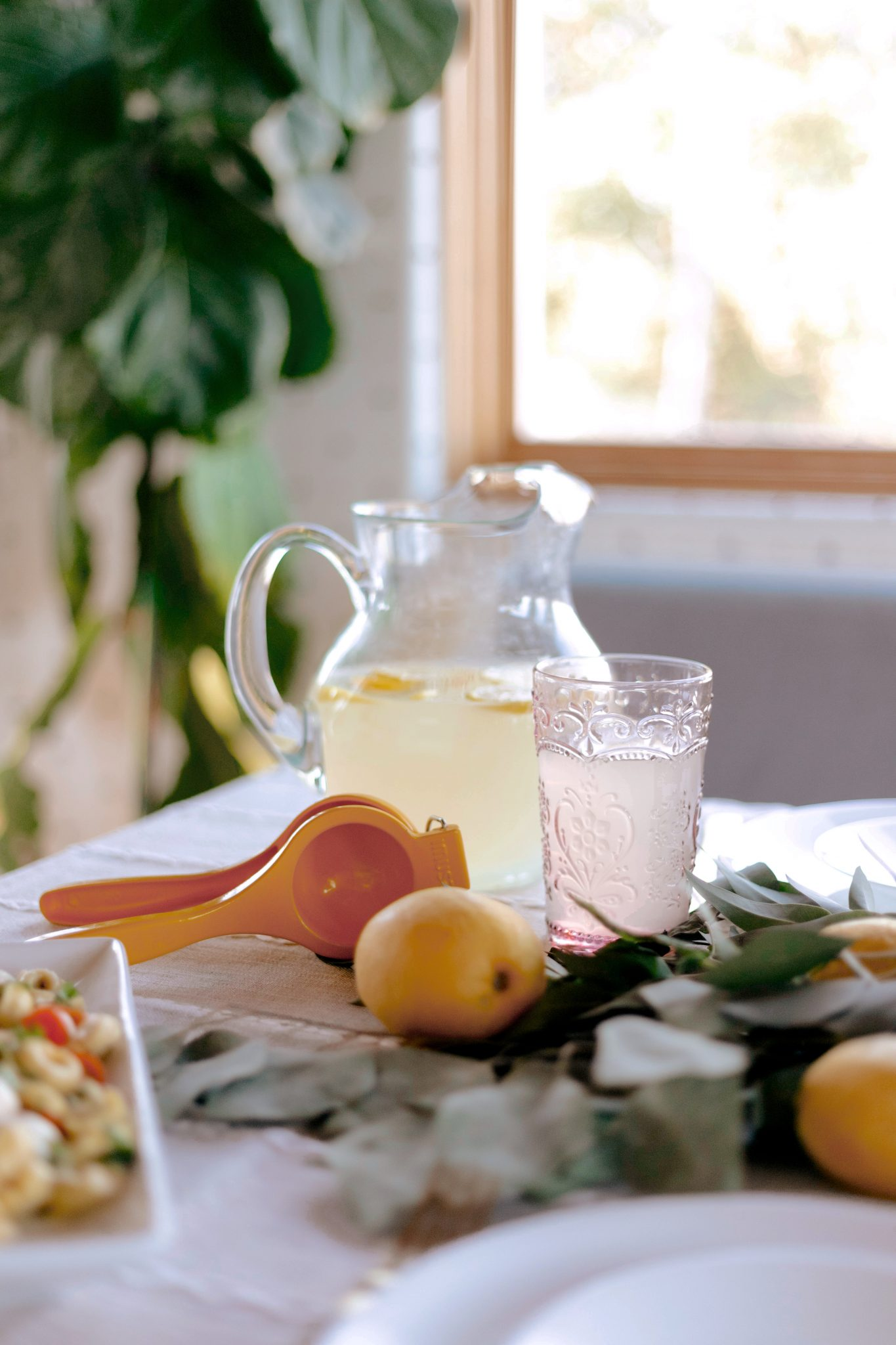 glass, pint, and fruits on table for hosting friends and family for dinner