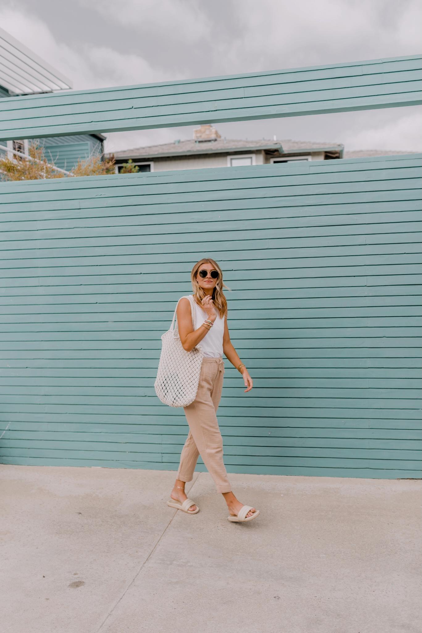 woman walking and smiling at the camera