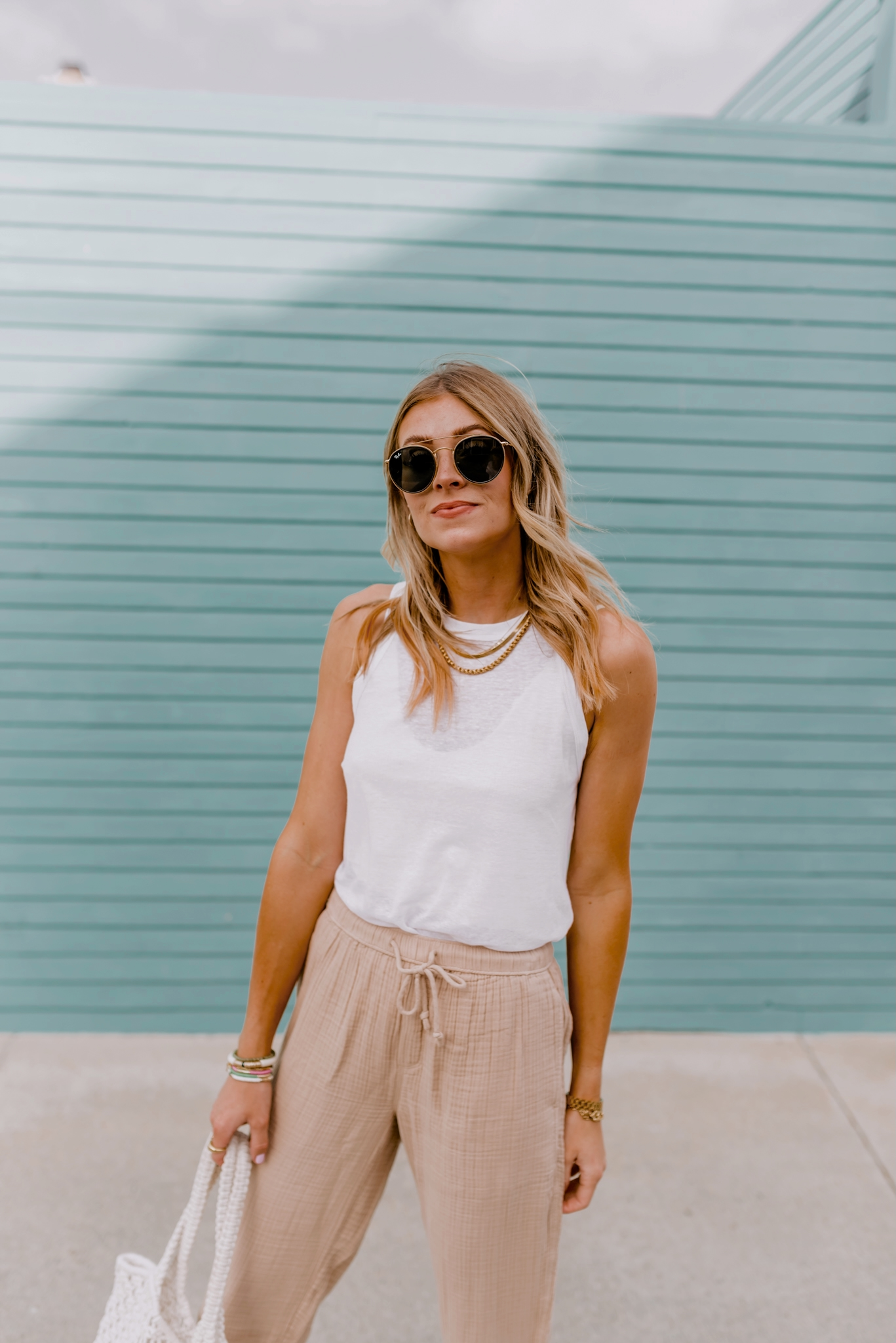 woman wearing white top and pants from Amazon home and fashion favorites