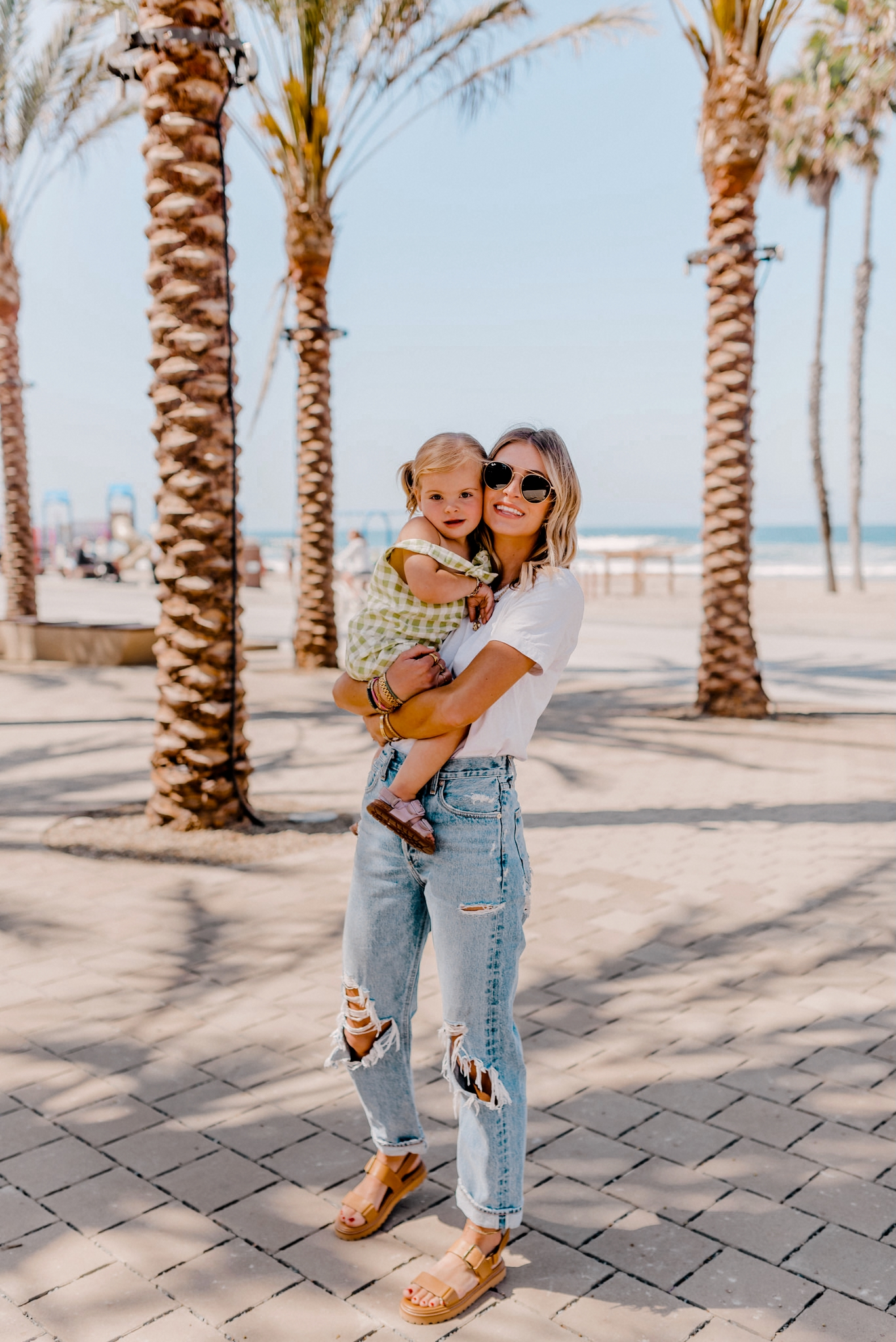 mom carrying her child and share KIDs NEW SUMMER ARRIVALS AND SWIMSUITS
