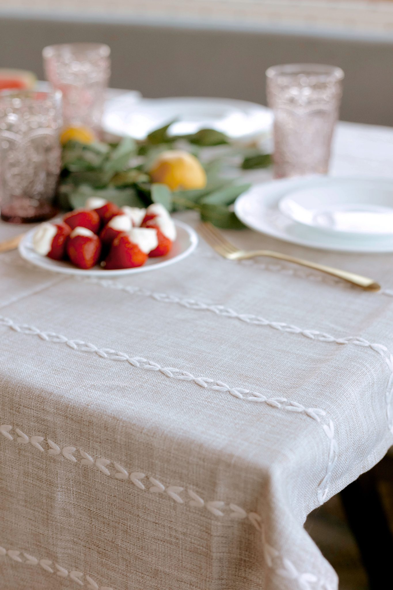 table with white cloth and fruits