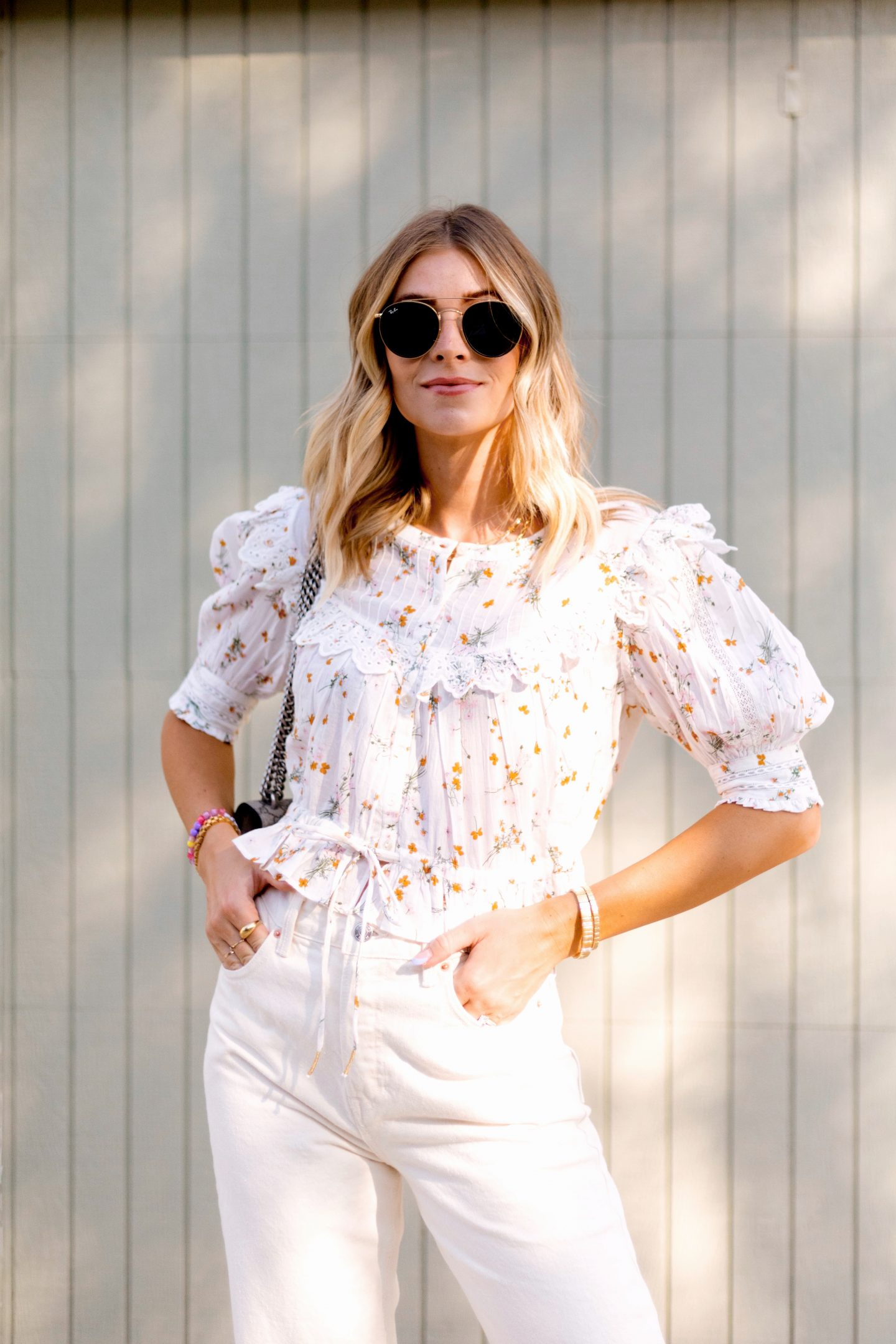 woman wearing printed top and sunglasses from august new arrivals