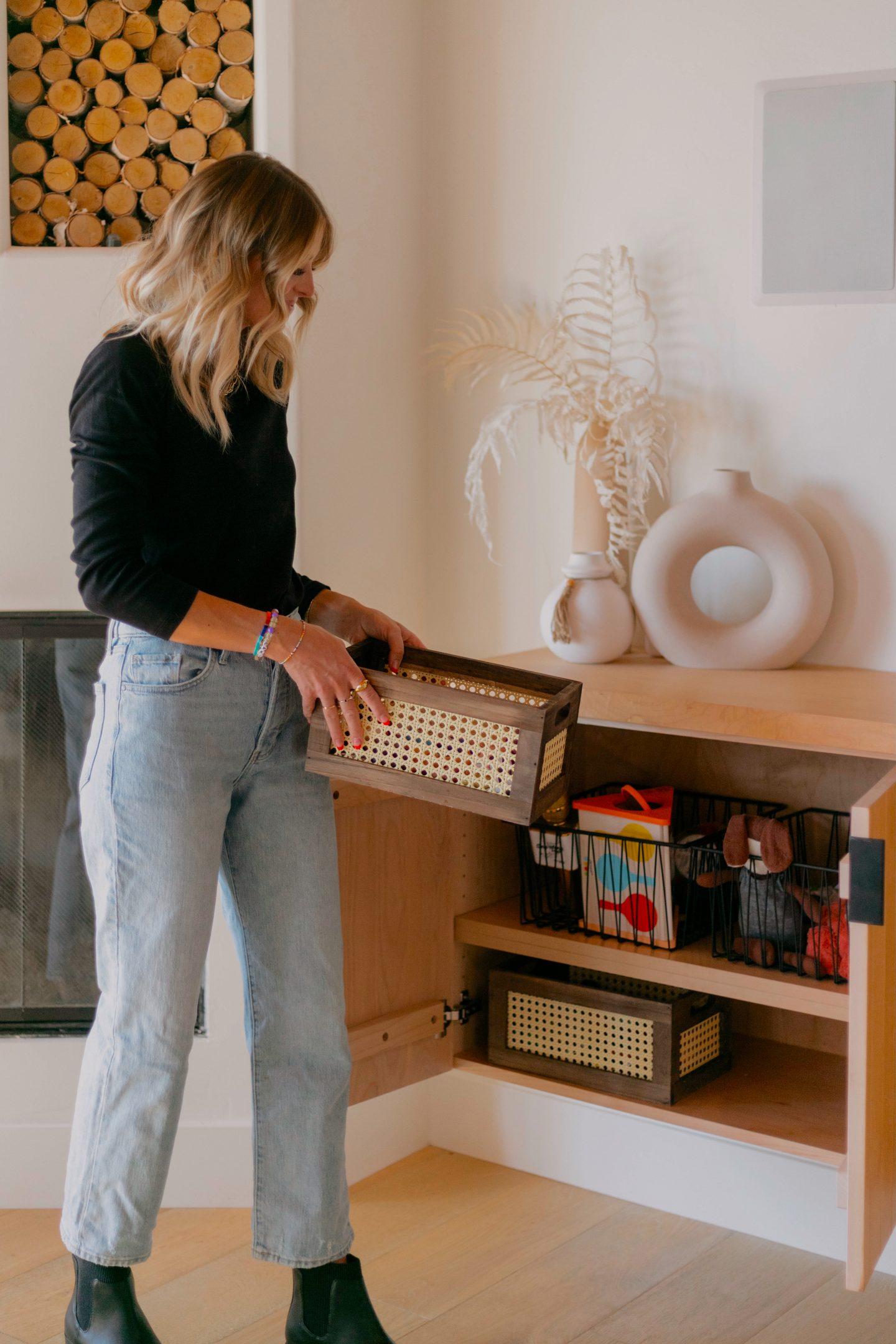 woman arranging baskets from walmart fall home decor