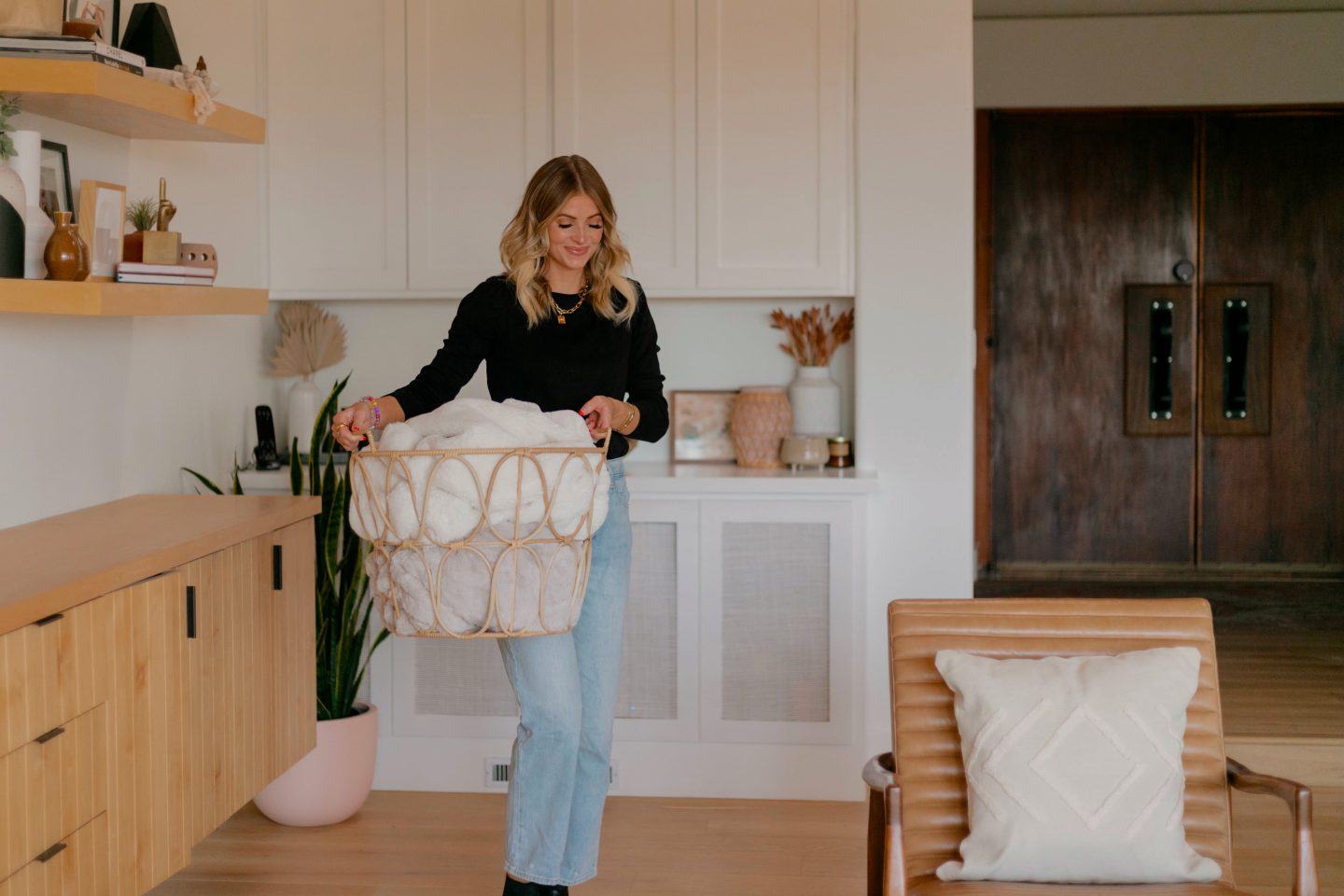 woman holding a basket with blankets from walmart fall home decor