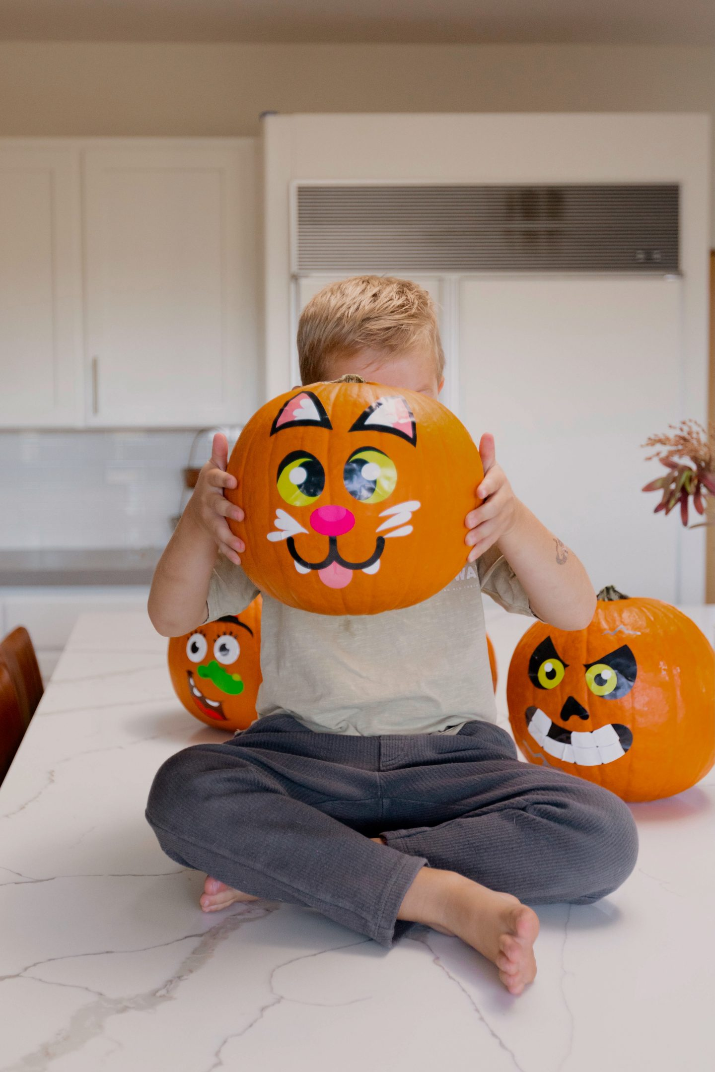 child holding a fall crafts and activities for kids