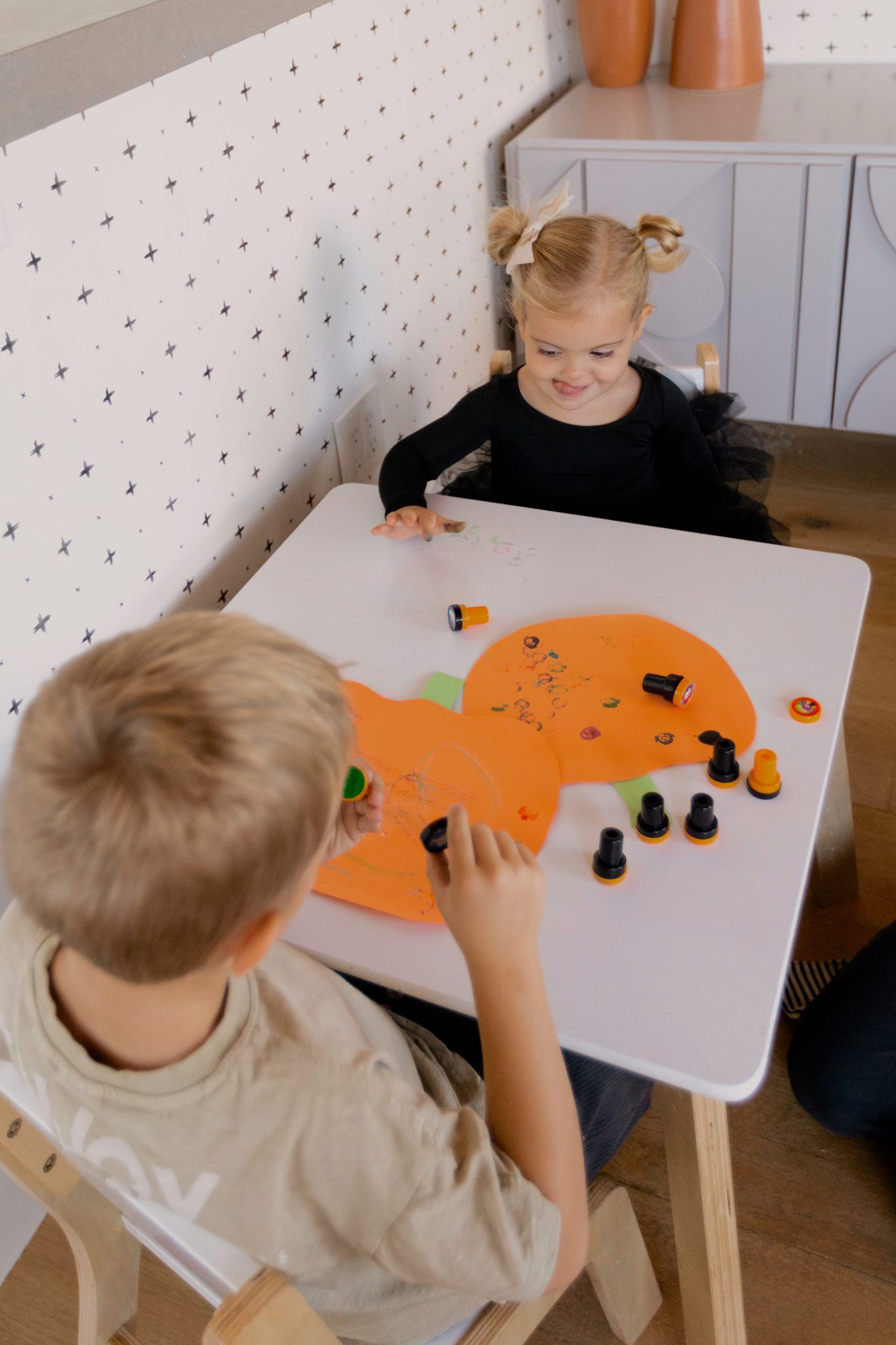 children playing with stamps