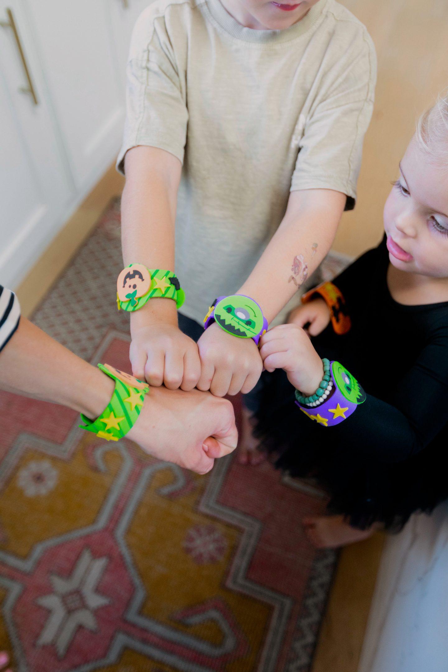 children wearing wristbands